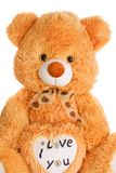 Teddy bear with heart shape Stock Images