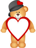 Teddy bear with heart shaped frame Royalty Free Stock Photography