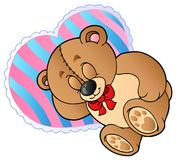 Teddy bear on heart shaped pillow Stock Photography