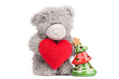 Teddy-bear with heart and tree Royalty Free Stock Image