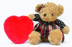 Teddy bear and heart on white Stock Photos