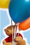 Teddy bear and his balloons Stock Images