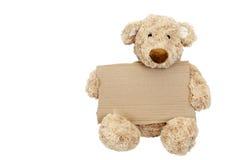 Teddy bear holding an add space Stock Photos