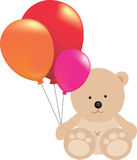 Teddy bear holding ballons Royalty Free Stock Image
