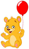 Teddy bear holding balloon Stock Image
