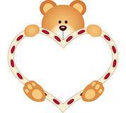 Teddy Bear holding Blank Heart Stock Images