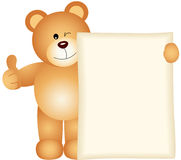 Teddy bear holding a blank sign Royalty Free Stock Photo