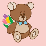 Teddy bear holding a bouquet of tulips Stock Image