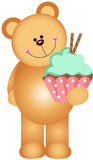 Teddy bear holding a cupcake Stock Image