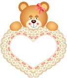 Teddy Bear holding Embroidered Heart Stock Photos