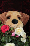 Teddy Bear Holding Flowers. Teddy bear holding a bouquet of flowers Stock Images