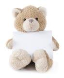 Teddy bear holding greeting card. Cute teddy bear holding greeting card on white background Royalty Free Stock Photo