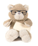 Teddy bear holding greeting card Stock Photo