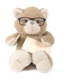 Teddy bear holding greeting card Stock Photo