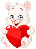 Teddy bear holding heart Stock Image
