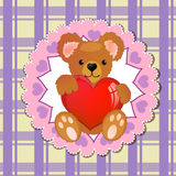 Teddy bear holding heart Stock Photo