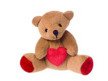 Teddy bear holding a heart Royalty Free Stock Images