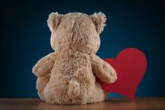 Teddy Bear Holding a Heart Stock Image