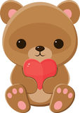 Teddy bear holding a heart Stock Image