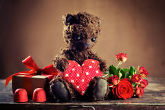 Teddy Bear Holding a Heart  and  gift box Stock Photo