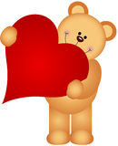 Teddy bear holding a heart Royalty Free Stock Image