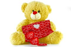 Teddy Bear Holding a Heart on white background.  Stock Photos