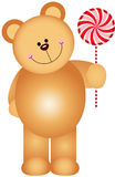 Teddy bear holding a lollipop Royalty Free Stock Image