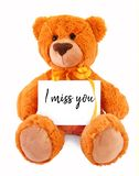 Teddy bear holding a message stock images