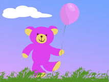 Teddy bear holding a pink balloon Stock Image