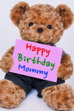 Teddy bear holding  pink sign saying Happy Birthday Mommy Royalty Free Stock Images