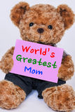 Teddy bear holding  pink sign saying World`s Greatest Mom Stock Photos