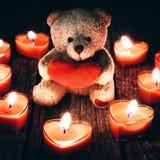 Teddy bear holding red heart Stock Photo