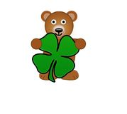 A Teddy Bear Holding Shamrock Stock Photography