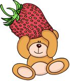 Teddy bear holding a strawberry Royalty Free Stock Images