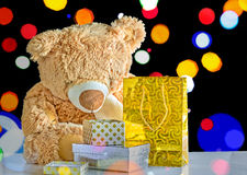 Teddy bear and holiday packages with gifts Royalty Free Stock Images