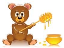 Teddy bear and honey Royalty Free Stock Photography