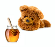 Teddy bear with honey jar Royalty Free Stock Photography