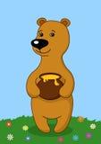 Teddy bear with a honey pot Royalty Free Stock Photo