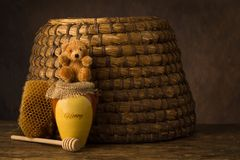 Teddy bear and honeypot with beehive royalty free stock images