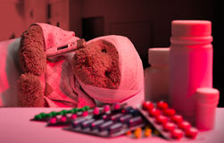 Teddy bear in hospital bed Stock Photos