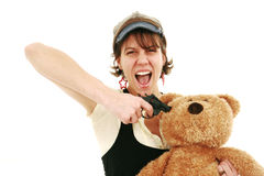 Teddy bear hostage. Woman with handgun holds teddy bear hostage Royalty Free Stock Photo