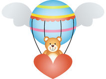 Teddy bear in a hot air balloon with angel wings Stock Photography