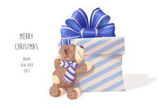 Teddy Bear hugging big gift Stock Photo