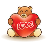 Teddy bear hugging a heart Stock Images