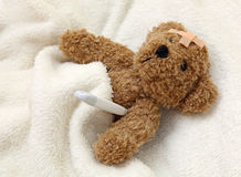 Teddy bear ill stock images
