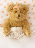 Teddy bear ill. In bed royalty free stock photos