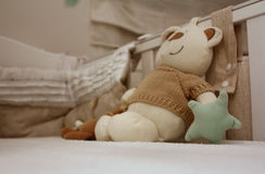 Teddy Bear inside Cot. Teddy bear inside a cot on a mattress Royalty Free Stock Images