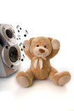 Teddy bear irritated by loud music Royalty Free Stock Image