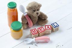 Teddy bear with jar of food Stock Photos