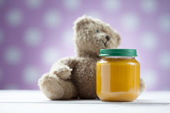 Teddy bear with jar of food Royalty Free Stock Image